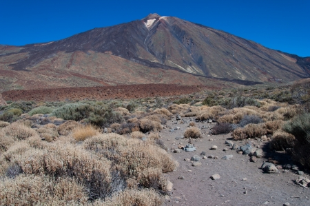 Teide is a volcano on Tenerife in the Canary Islands  Its 3,718-metre  12,198 ft  high summit is the highest point in Spain, the highest point above sea level in the islands of the Atlantic, and it is the third highest volcano in the world measured from i photo