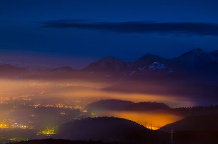 A night exposure over Brasov city with Piatra Mare mountains in the background photo