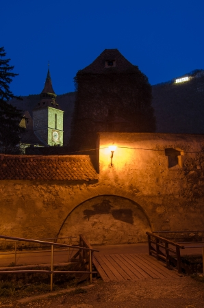 Black church view, behind the old city walls, in Brasov Romania photo