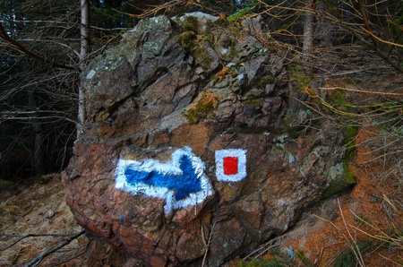Indicator sighn in the mountain, marked on the stone photo