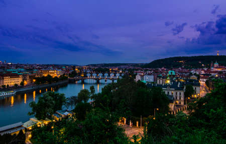 Skyline view over the Vltava river and bridges in Prague at sunset, Czech Republic photo