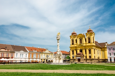 Unirii Square in Timisoara, Romania with Roman Catholic Episcopal Church in background photo