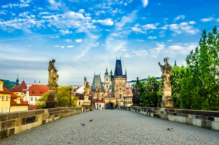 Charles bridge with its statuette, Lesser Town Bridge Tower and  the tower of the Judith Bridge  which was Prague s first stone bridge built in the first half of the 12th century   The Mala Strana  Фото со стока