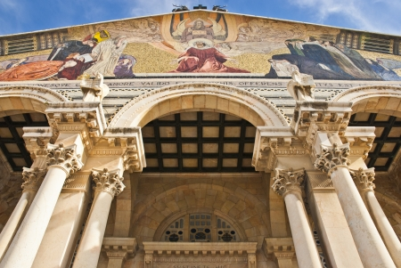 The Church of All Nations also known as the Basilica of the Agony  It is a Roman catholic church located on the Mount of Olives in Jerusalem, Israel  The mosaic on the facade shows Jesus as the mediator between God and man  photo
