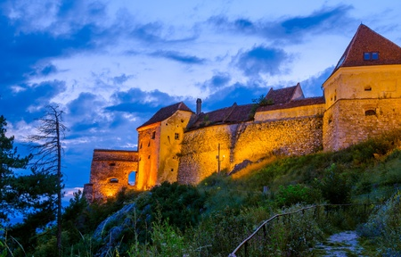 Night-view of a medieval fortress in Transylvania photo