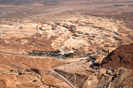 judaean desert: Touristic resort in Judaean Desert at the base of the mountain were Masada fortress was built by the Herod the great