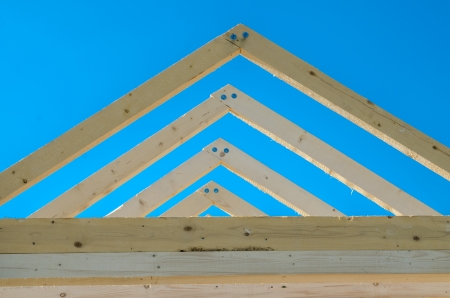 rafters: Rafters of the roof frame of a house under construction
