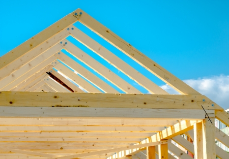 Rafters of the roof frame of a house under construction photo