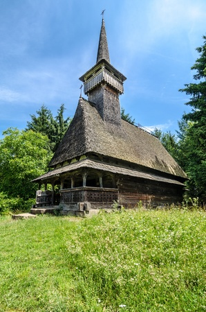 Traditional wood church from Maramures, Romania  Romanian traditional architectural style, life in the countryside  photo