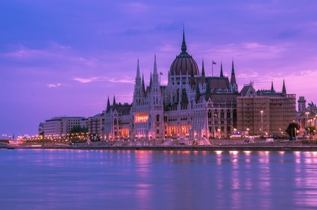 Side view of the beautiful historic Hungarian parliament building at early dawn photo