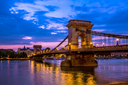 Szechenyi Chain Bridge is a suspension that spans the River Danube between Buda and Pest, in Budapest, the capital of Hungary  It was the first permanent bridge across the Danube in Budapest photo