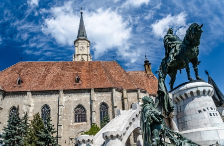 The Church of Saint Michael is a Gothic-style Roman Catholic cathedral in Cluj, second largest church in Transylvania, Romania, completed in 1442-1447 Statue of King Mathias  Matyas, Matei, Corvinus  Фото со стока