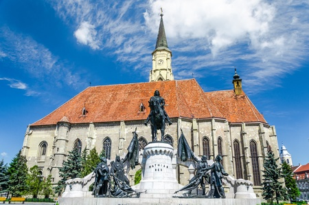 The Church of Saint Michael is a Gothic-style Roman Catholic cathedral in Cluj, second largest church in Transylvania, Romania, completed in 1442-1447 Statue of King Mathias  Matyas, Matei, Corvinus Reklamní fotografie - 22013322