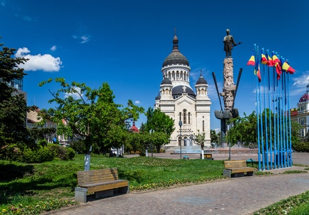 Avram Iancu Square,Cluj-Napoca,Romania with the statue of Avram Iancu the leader of romanian revolution from Transylvania 1848-1849  and the Orthodox Cathedral of Cluj, Alba,Crisana and Maramures photo