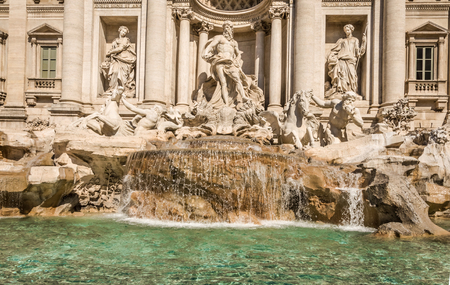 italian fountain: The Trevi Fountain  Italian  Fontana di Trevi  is a fountain in the Trevi rione in Rome, Italy  Standing 25 9 meters high and 19 8 meters wide, it is the largest Baroque fountain in the city  Stock Photo