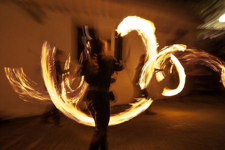Night dance scene with fire performance outdoor  photo
