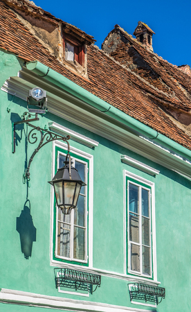 Architectural detail in Sighisoara, most beautiful and well preserved inhabited citadel in Europe, with authentic medieval architecture and one of the few fortified towns that are still inhabited  photo