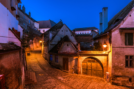 Old street of residential buildings in Sibiu, town in Transylvania, Romania photo