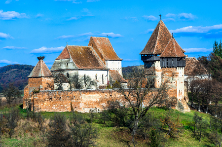 alma: Fortified Church in Transylvania, Romania  Alma Vii rural church was built in 16th century by saxons in gothic architecture style  Stock Photo