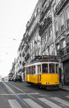 electrico: The Number 28 tram in motion blurr, running through Lisbon, Portugal