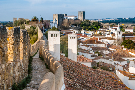 A view of the fortified wall in Obidos, Portugal  The name Obidos probably derives from the Latin term oppidum, meaning citadel, or fortified city photo