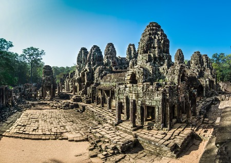 The Bayon Temple is one of the most significant historical and religious sites in the Angkor Thom area  The ruins feature over one hundred huge faces carved into the towers  photo