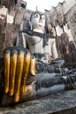 700 years ancient big buddha statue Sukhothai,Thailand  Named Talkable buddha statue, Wat Si Chum temple, Sukhothai, Thailand photo