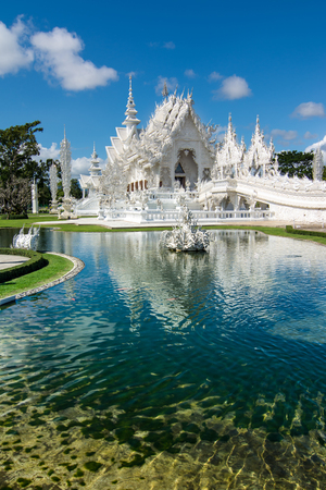Beautiful ornate white temple located in Chiang Rai northern Thailand  Wat Rong Khun  White Temple , is a contemporary unconventional Buddhist temple  photo