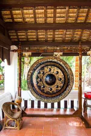Black decorated gong in a budhist temple in Thailand,use in buddha religion photo