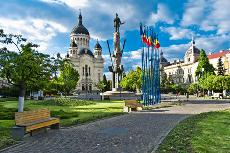 cluj: Avram Iancu Square,Cluj-Napoca,Romania with the statue of Avram Iancu the leader of romanian revolution from Transylvania 1848-1849  and the Orthodox Cathedral of Cluj, Alba,Crisana and Maramures