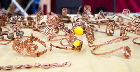 Hand made copper bracelet made from tisted and hammered wire Reklamní fotografie - 27355759