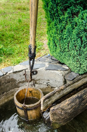 Old vintage well with a bucket and leverage in Maramures Romania Reklamní fotografie - 27254494