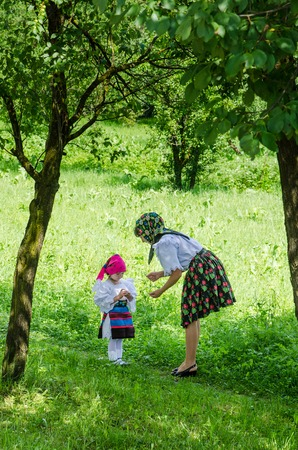 Maramures, Romania, June 24 2013 - Mother and dother in national port