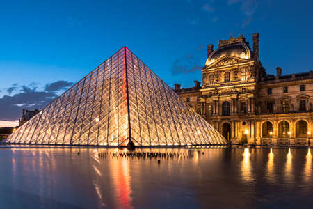 The Louvre, Paris, at twilight, one of the major tourist attractions in France and in Europe