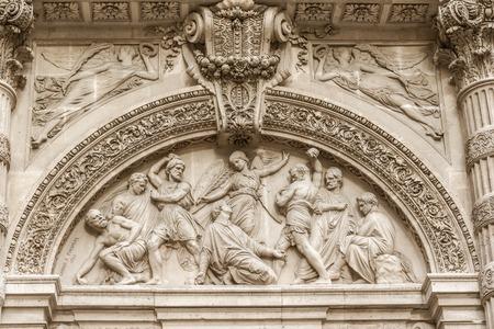martyrdom: The Martyrdom of St  Stephen, pediment of the front door of Saint-Etienne-du-Mont, Paris, France, near the Pantheon  It contains the shrine of St  Genevieve, the patron saint of Paris