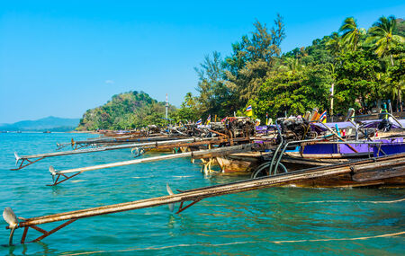 railey: Longtail boats on Railey beach, Krabi, Thailand  Beautiful scenery with blue water and limestone cliffs Stock Photo
