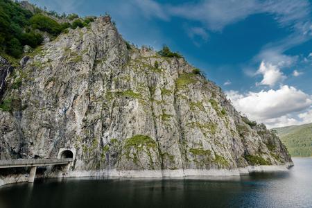 You can easily reach Vidraru Lake by following the Transfagarasan Rode. Vidraru Lake has an aria of 893 hectares and it is 155 meters deep. photo