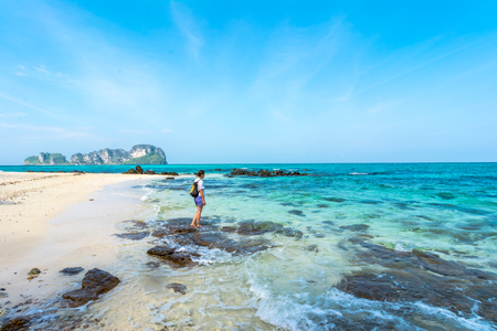 exceptionally: Tourist on the beach in Thailand, Asia. Bamboo Island in Thailand- blue sky and with silky soft white sand, and exceptionally clear water Stock Photo