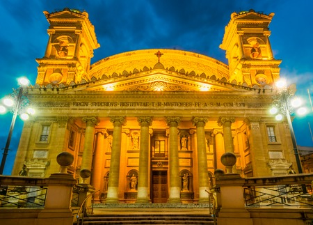 The Famous St Marys Church in Mosta in Malta sometimes known as the Rotunda of Mosta or the Mosta Dome. It is the third largest dome church in Europe. Church facade at the twilight photo