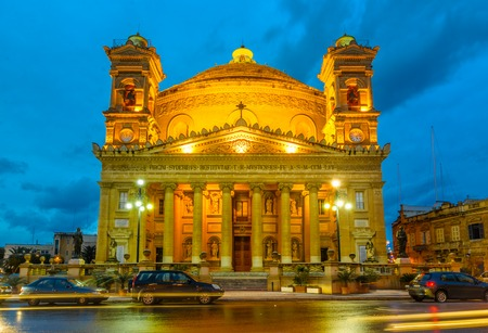 church tower: The Famous St Marys Church in Mosta in Malta sometimes known as the Rotunda of Mosta or the Mosta Dome. It is the third largest dome church in Europe. Church facade at the twilight Stock Photo