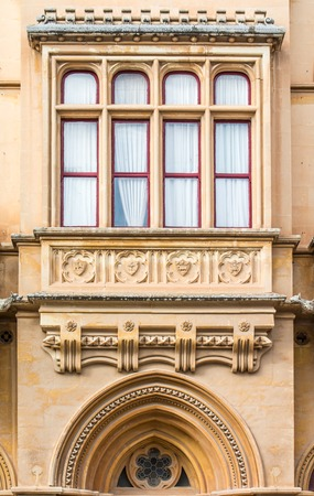 pawl: Architectural detail of a beautiful classic Gothic architecture on a house in the old city of Mdina in Malta at Pjazza San Pawl.
