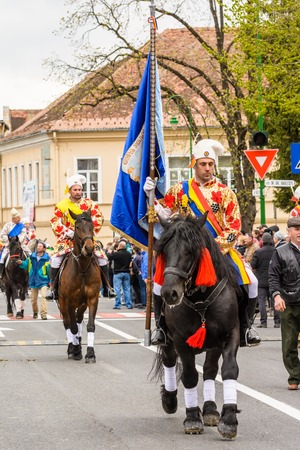 permitted: Brasov Romania April 19 2015: Horsemen riding during the traditional parade Juni Brasovului marking the only day of the year when Romanians were permitted to enter in the Saxon town of Kronstadt .