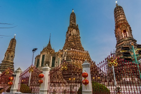 colourfully: Wat Arun or Wat Chaeng, is situated on the west bank of the Chao Phraya River. Wat Arun or temple of the dawn is partly made up of colourfully decorated spires and stands majestically over the water.