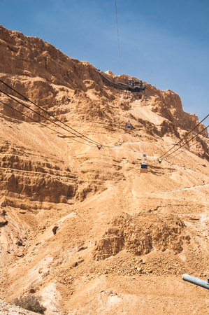 holy land: Tranpost to the top of Massada hill by the Cable Car. Judea Desert, Israel. Holy Land.