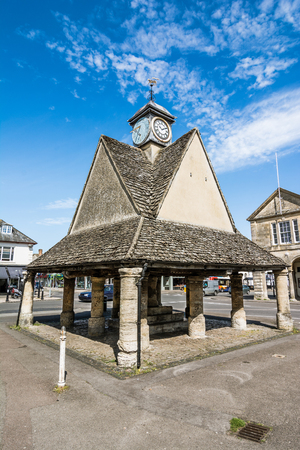 openair: The small roofed open-air shelter known as the Butter Cross in the market place, near to the Town Hall, was erected in 1683, replacing the old Butter Cross which formerly stood on this site Stock Photo