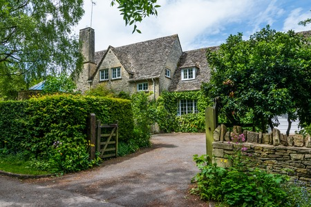 Lovely old cotswold stone house in Witney,Oxfordshire, England, UK Фото со стока