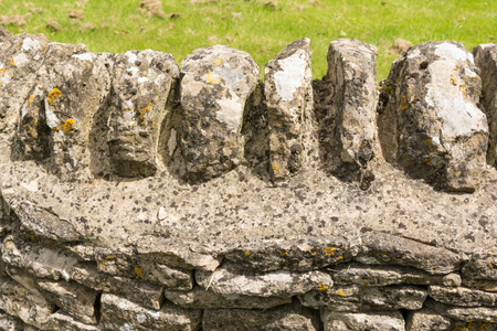 dry stone: Traditional dry stone wall in cotswolds village, England Stock Photo