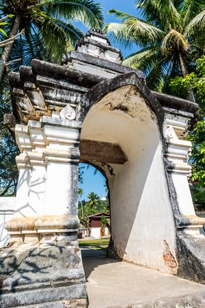 uniquely: Entrance to Wat Aham, Luang Prabang, Laos.The wat lies adjacent to Wat Wisunalat and that monasterys uniquely impressive That Makmo the Watermelon Stupa Stock Photo
