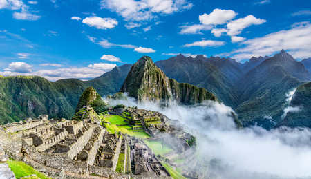 Overview of Machu Picchu, agriculture terraces, Wayna Picchu and surrounding mountains in the background