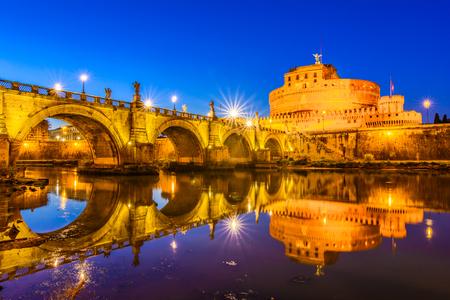tiber: Night view over the Tiber river and the SantAngelo bridge Stock Photo